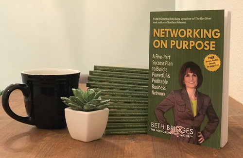 Stack of Networking on Purpose books with a cup of coffee